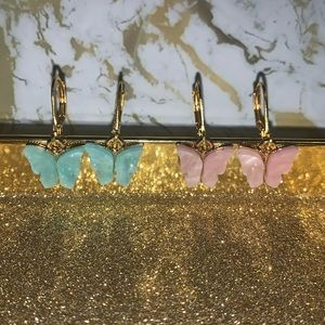 Beautiful butterfly earrings in baby pink and blue
